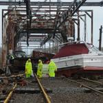 Customers boat floated over 6 foot fence and onto NJ Transit tracks.  Sandy 2012